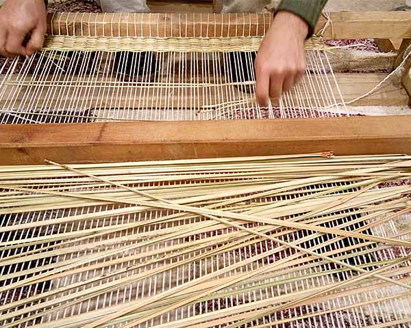 Loom of handmade mats